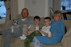 Dad, Mother, Oldest Boy, Middle Boy, and Mary relaxing - Christmas 2008