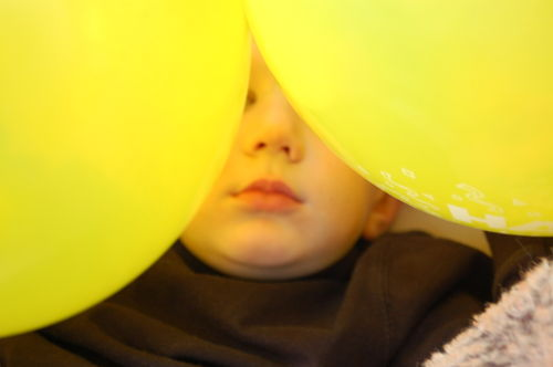 Toddler Child with balloons