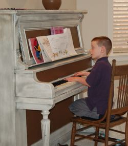 Middle Boy practicing piano - Spring 2006.