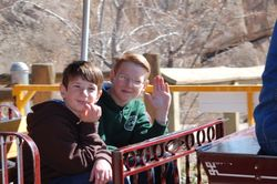 Oldest Boy and Middle Boy riding the zoo train - March 2009