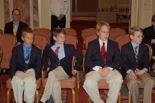Middle Boy, Oldest Boy and friends enjoying a break. Chris in the back of the room.