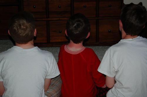 """Ross Boys watching """"Clone Wars"""" with sunburns - March 2009"""