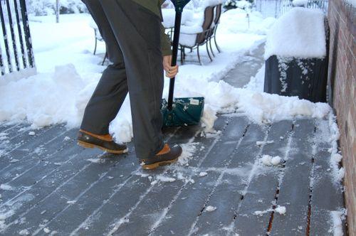 Chris shoveling snow on April 16th
