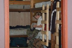 Oldest Boy checking his blood sugar at camp. June 2009