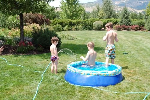 Funky white boys playing in the hose.