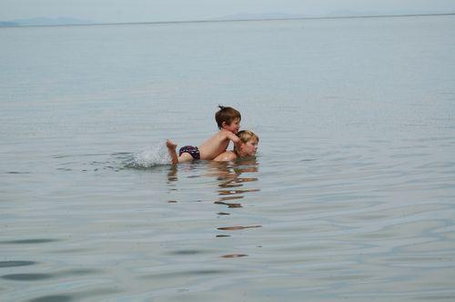 Oldest Boy, Toddler Child in lake with brine flies