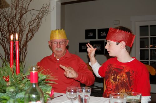 """Middle Boy teaching Papa Parke how to sign """"rock on"""""""