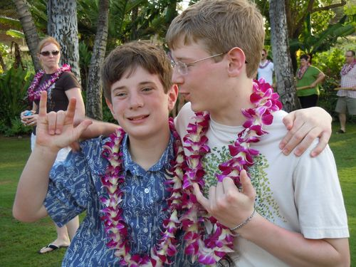 """Middle Boy trying to sign """"Hang Loose"""""""