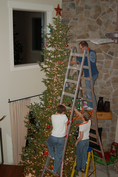 Chris and boys decorating tree - Christmas 2010